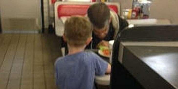 Josiah prays with the homeless man...