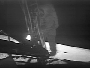 Neil Armstrong steps onto the surface of the Moon...
