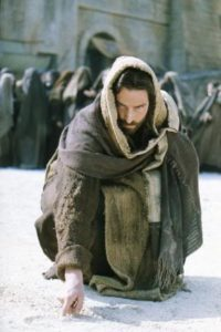 But Jesus stooped down, and with his finger wrote on the ground, as though he heard them not .. John 8:6